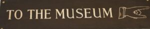 Enter the museum sign